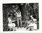 Teresa Bakos, John Sloan, Jozef Bakos, Dolly Sloan and Will Shuster under a trellis at Sloans Santa Fe Ranch