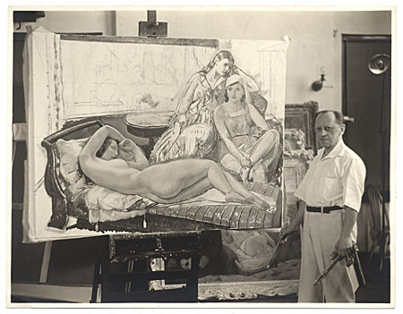 [Leon Kroll standing next to one of his paintings]