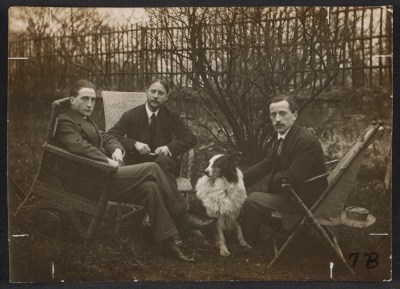 Marcel Duchamp, Jacques Villon, Raymond Duchamp-Villon, and Villons dog Pipe in the garden of Villons studio, Puteaux, France