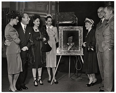 Walt Kuhn, Bert Lahr and others at the unveiling of his portrait of Lahr as a burlesque actor
