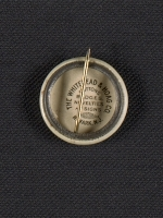 [Armory show button and lapel pin verso 2]