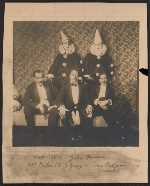 Walt Kuhn, John Quinn and others dressed for a Kit Kat Club or Penguin Club artists ball