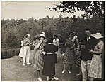 [Carl Walters with others at an outdoor party.]