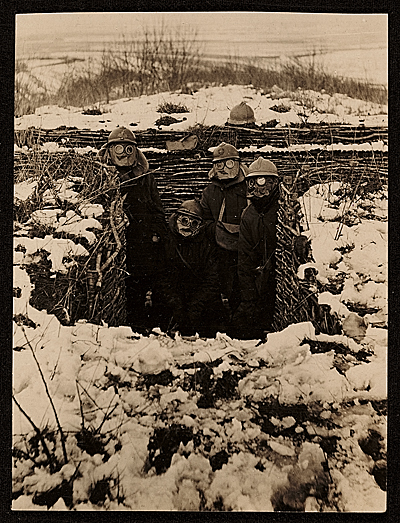 WWI soldiers wearing gas masks in trenches