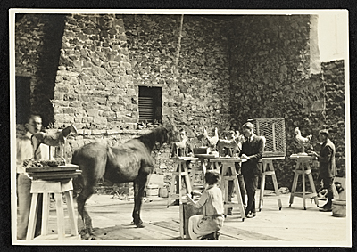 Art students making sculptures of a horse