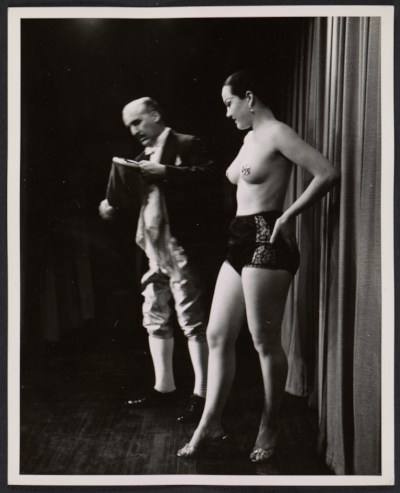 [Abril Lamarque and an unidentified woman onstage performing a magic trick]