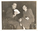 [Abril Lamarque showing a deck of cards to an unidentified woman ]