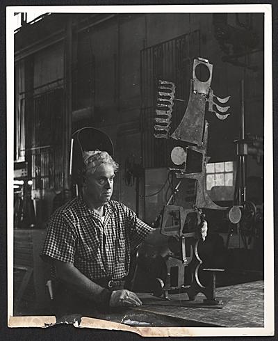 Pietro Lazzari in his studio with his sculpture, Toreador