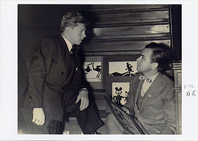 Douglas Leigh with Mickey Rooney with images of early EPOK signs