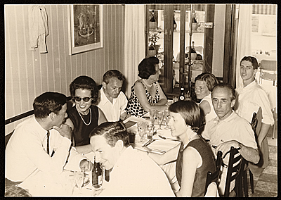 Robert Rauschenberg, Leo Castelli and others at a dinner in Venice, Italy