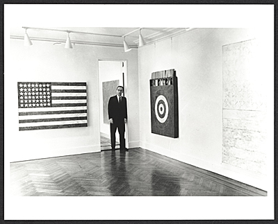 [Leo Castelli in a room of the Jasper Johns exhibit at the Castelli Gallery]