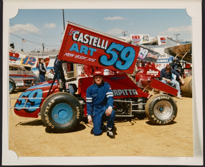 Bobby Essick kneeling in front of Castelli Art car no. 59