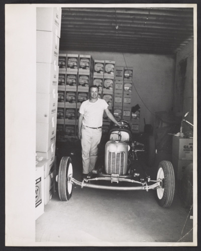 Salvatore Scarpitta with race car, unidentified photographer