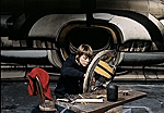 [Lee Bontecou working on a sculpture in her studio]