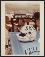 Salvatore Scarpitta in race car with helmet on hood