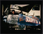 Salvatore Scarpitta in his dirt track race car, no. 59