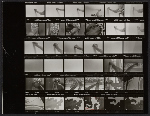 Contact sheet of negatives showing assistants with Greene Street Mural