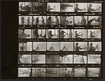 Contact sheet of negatives showing Roy Lichtenstein and assistants with Greene Street Mural