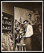Jack Levine working on a painting