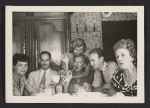 Group of unidentified people eating and drinking together