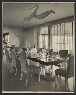 Dining room with chairs upholstered in fabric by Dorothy Liebes