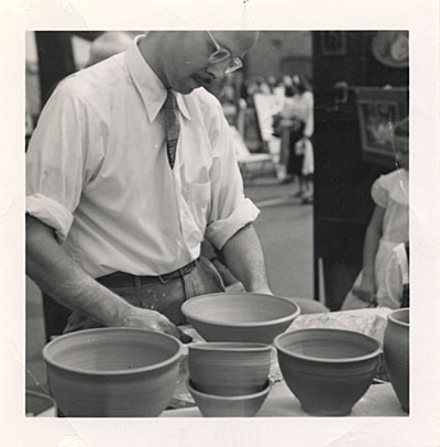 [Harvey Littleton throwing pots]