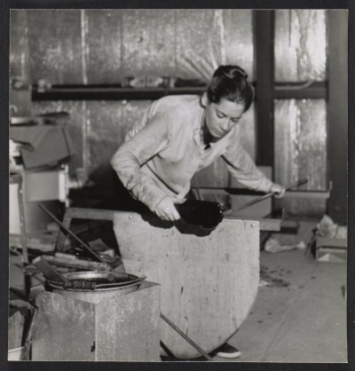 [A Madison Glass Workshop student blocking a piece of glass.]