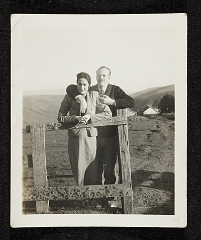 Erle and Clyta Loran standing at a fence