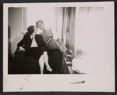 Marcella Brenner and Morris Louis seated in an armchair
