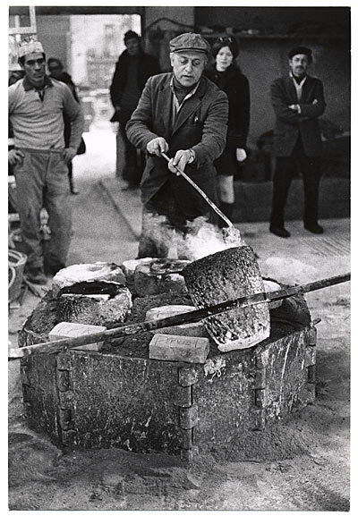 [Herzl Emanuel at his forge]