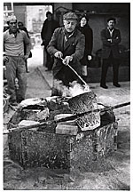 [Herzl Emanuel at his forge ]
