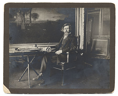 [George Inness seated in his studio]