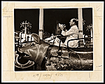 Reginald Marsh sketching on the carousel at Coney Island