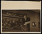 Edward Melcarth in front of his painting entitled Last Supper