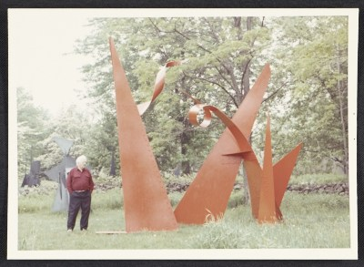 Alexander Calder standing by stabile The 100 yard dash