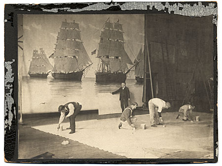 Francis Davis Millet, and assistants, at work, in his studio, on the mural The History of Shipping from the Earliest Recorded Use of Boats until the Present Time
