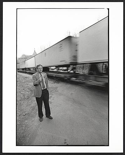 [John Caldwell by the railroad tracks]