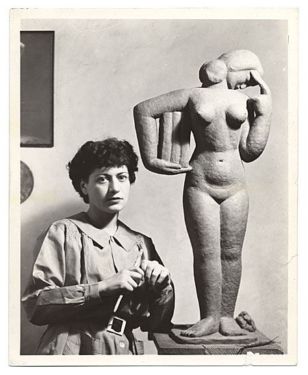 [Unidentified female sculptor with her work]