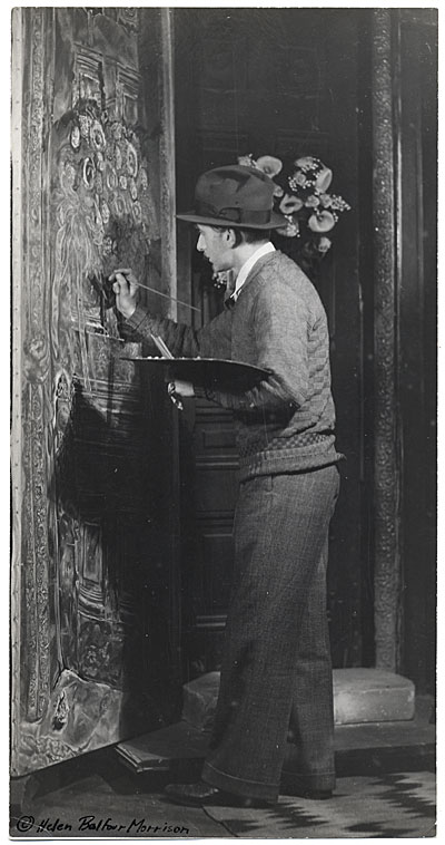 Ivan Albright painting in his studio