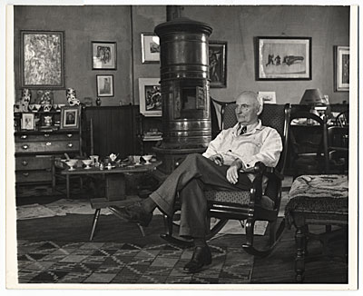 Carl Ruggles seated in a chair