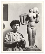 Unidentified female sculptor with her work