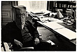 [Saul Steinberg wearing a mask at his desk]