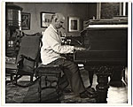 Carl Ruggles playing the piano