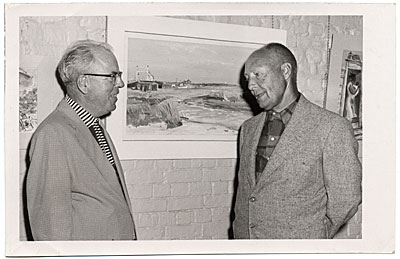 Bruce Mitchell and Dr. Bower with one of Mitchells paintings.