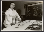 Nanae Momiyama working on an ink drawing