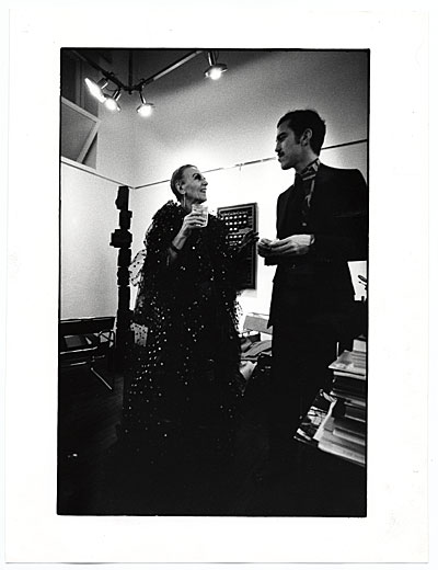 Louise Nevelson talking with an unidentified man at an exhibition opening