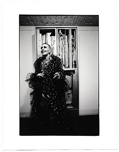 [Louise Nevelson at an exhibition opening of her work]
