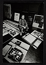 Louise Nevelson sitting among artwork in her studio