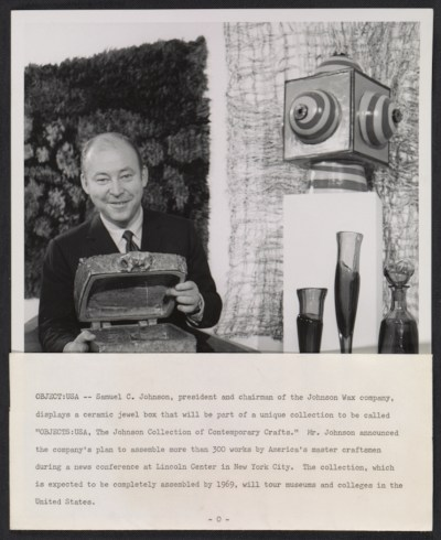 Samuel C. Johnson displaying ceramic box from the Objects: USA exhibition