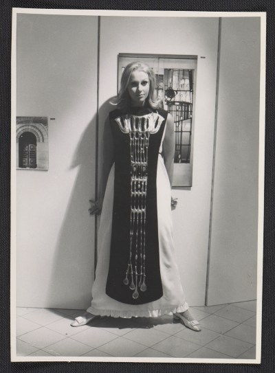 Woman modeling body ornament made by Arline Fisch